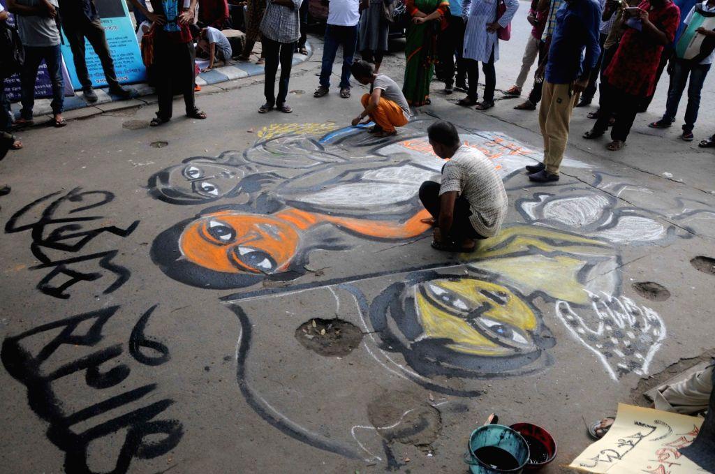 Artists protest against Mandsaur rape case through their art in Kolkata, on July 6, 2018.