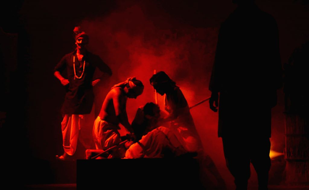 Artists stage a play based on Munshi Premchand's story Sadgati in Patna on August 1, 2014. (Photo: IANS)