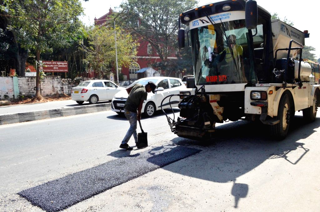 ARTS (American Road Technology and Solutions Private Ltd.) vehicle filling potholes at palace road, in Bengaluru on Monday 25th January 2021