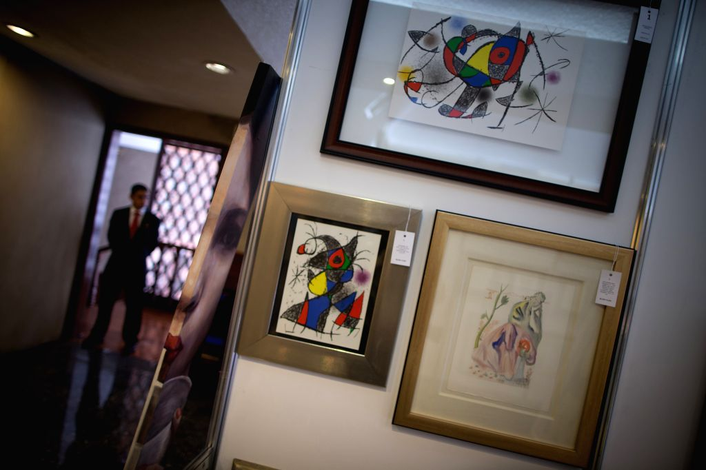 Artworks of Joan Miro and Salvador Dali are seen in an exhibition for the auction of Casa Morton in Mexico City, capital of Mexico, Aug. 17, 2015. A total of ...