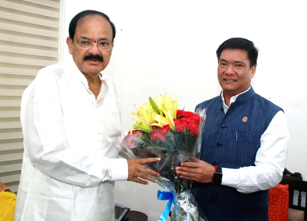 Arunachal Pradesh Chief Minister Pema Khandu calls on Vice President M. Venkaiah Naidu in New Delhi on Aug 18, 2017. - Pema Khandu and M. Venkaiah Naidu
