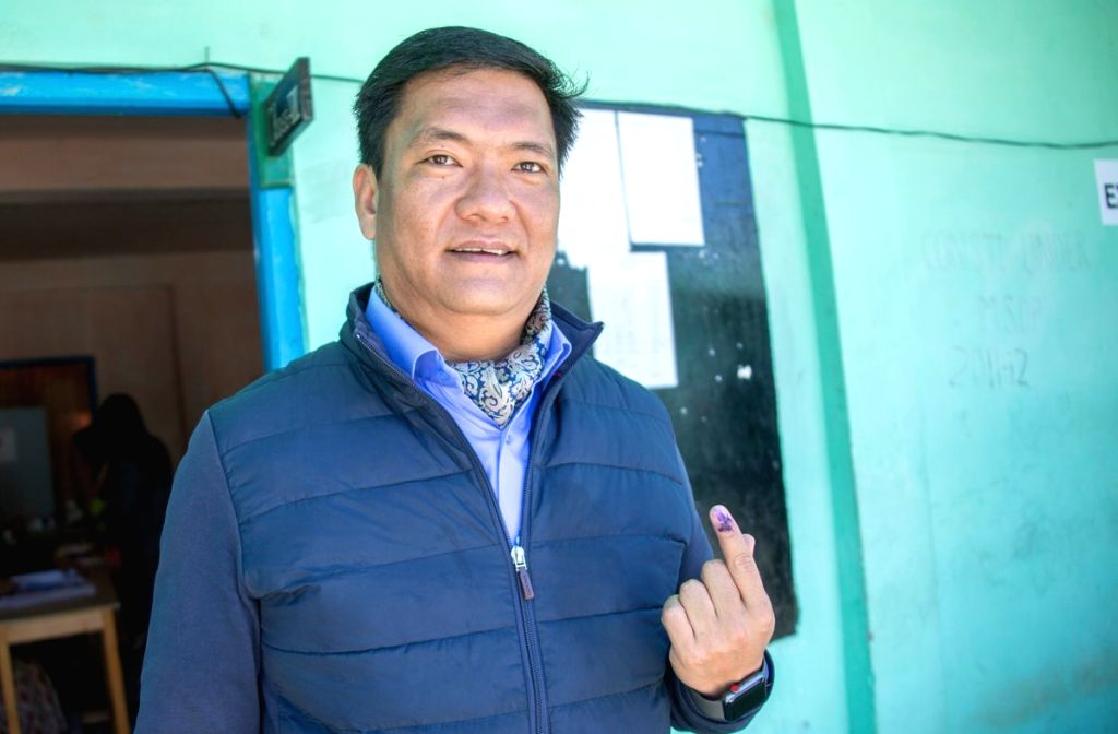 Arunachal Pradesh Chief Minister Pema Khandu shows his inked finger after casting his vote for the first phase of 2019 Lok Sabha elections, at Lemberdung polling booth in Tawang on April 11, ... - Pema Khandu