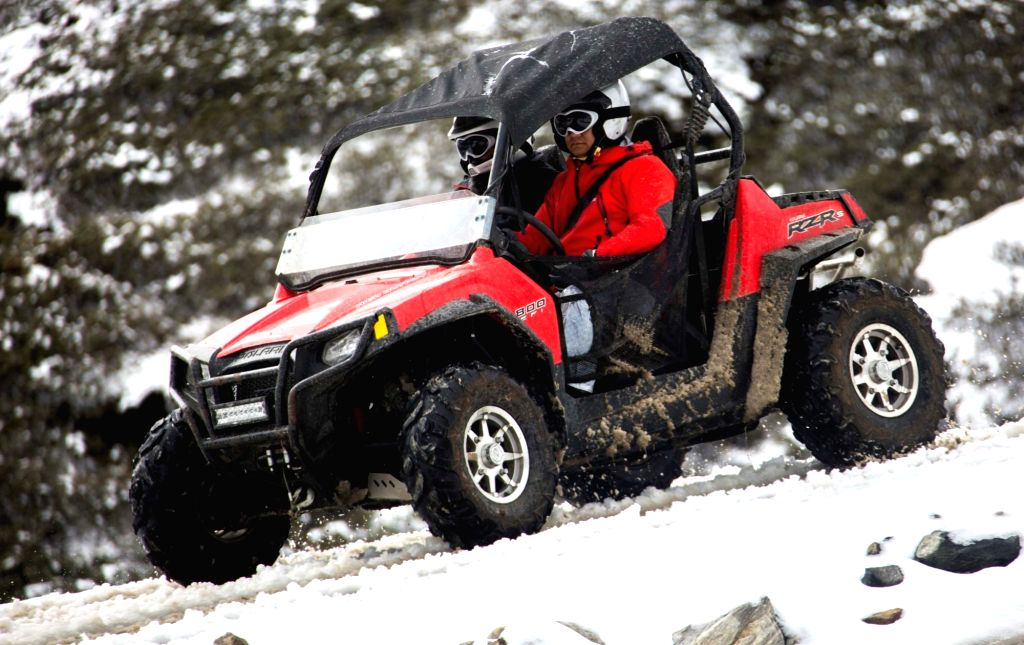 Arunachal Pradesh Chief Minister Pema Khandu takes a ride on an All Terrain Vehicle (ATV) from PTSO Lake to Mago near Indo-China border in Tawang district of the state on Oct 27, 2019. - Pema Khandu