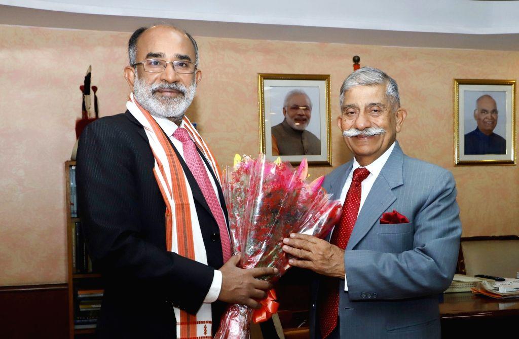 Arunachal Pradesh Governor B.D. Mishra meets Union MoS Tourism Alphons Kannanthanam, in New Delhi, on Feb 13, 2019. - D. Mishra