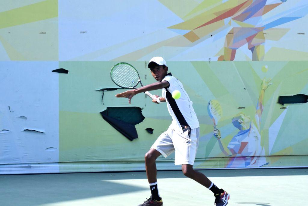 Arunava Majumdar in action against Shafaat Ali Asghar in Boys U-14 category of the Fenesta Open Junior National Tennis Championship, in New Delhi on Oct 9, 2019.