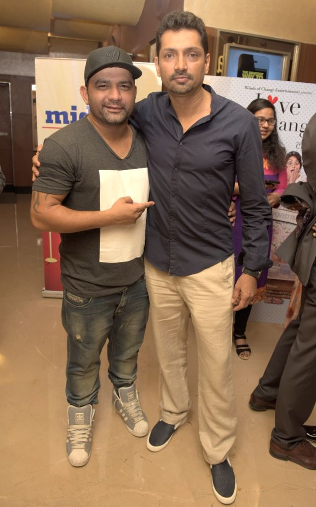 Arvind Sawant with Raj V.Shetty (Director) during the premiere of film Love Exchange in Mumbai on Oct 28, 2015.