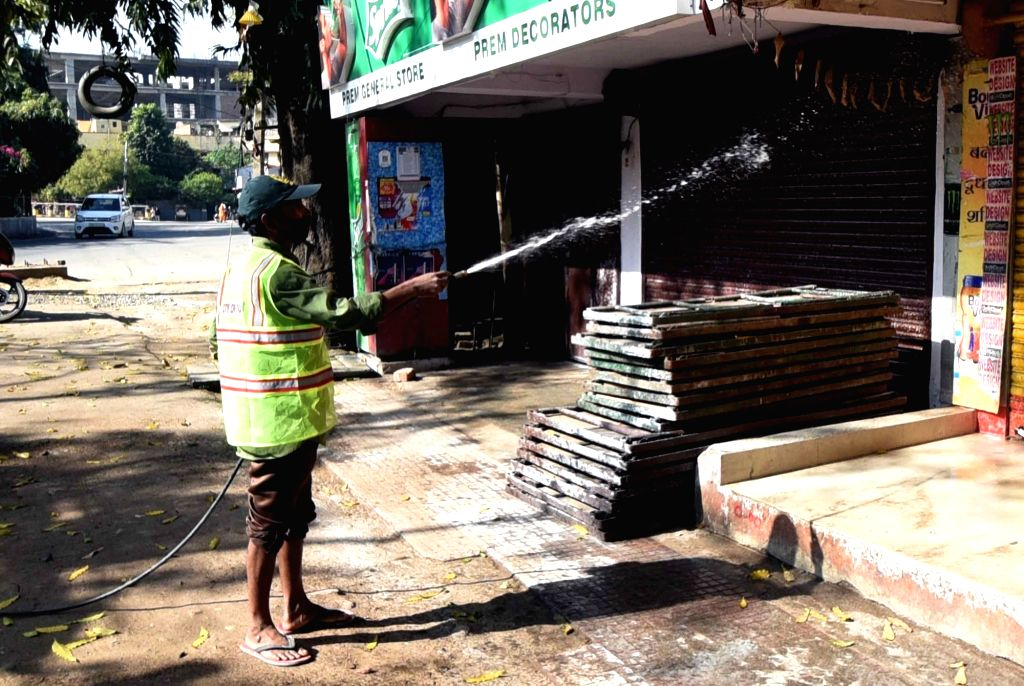 Arya Kumar Road being sanitised by Municipality workers on Day 2 of the 21-day nationwide lockdown imposed by the Narendra Modi government over the coronavirus pandemic; in Patna on March ... - Narendra Modi and Arya Kumar Road