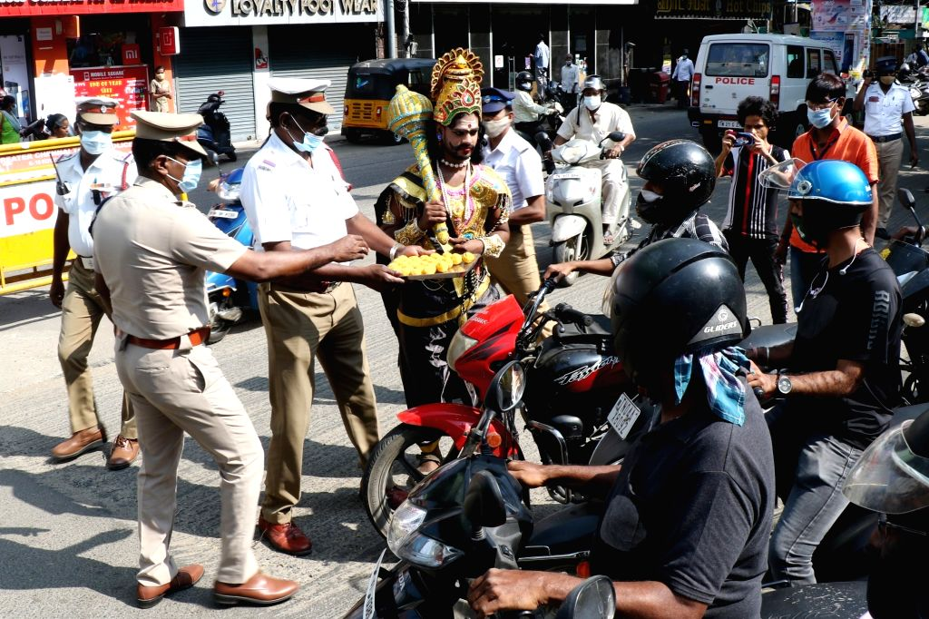 As a part of the Road Safety awareness YamadharmaRaja stops two wheelers with people not wearing their helmets in Chennai on tuesday, January 19,2021