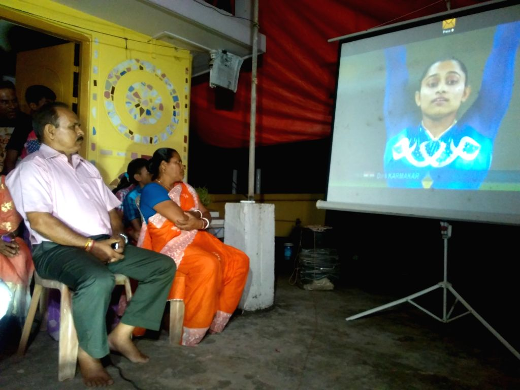 As Dipa Karnakar takes part in the final of gymnastics vault at Rio Olympics, her parents watching in a giant screen in Agartala August 14, 2016.