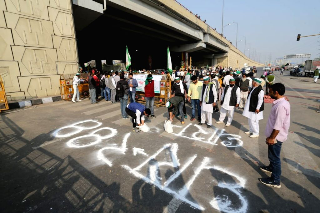 As the State authorities imposed Section 144 of the CrPC at the national capital's borders, the farmers protesting against the Centre's new Farm Laws at the Delhi-UP's Ghazipur border ...