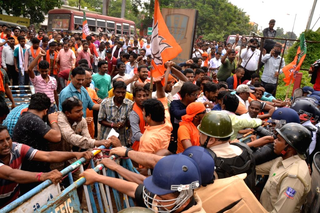 Asansol: BJP workers protesting against the ongoing political violence in West Bengal, 'gherao' Asansol Durgapur Police Commissionerate, in West Bengal's Asansol on June 24, 2019. (Photo: Indrajit Roy/IANS) - Indrajit Roy