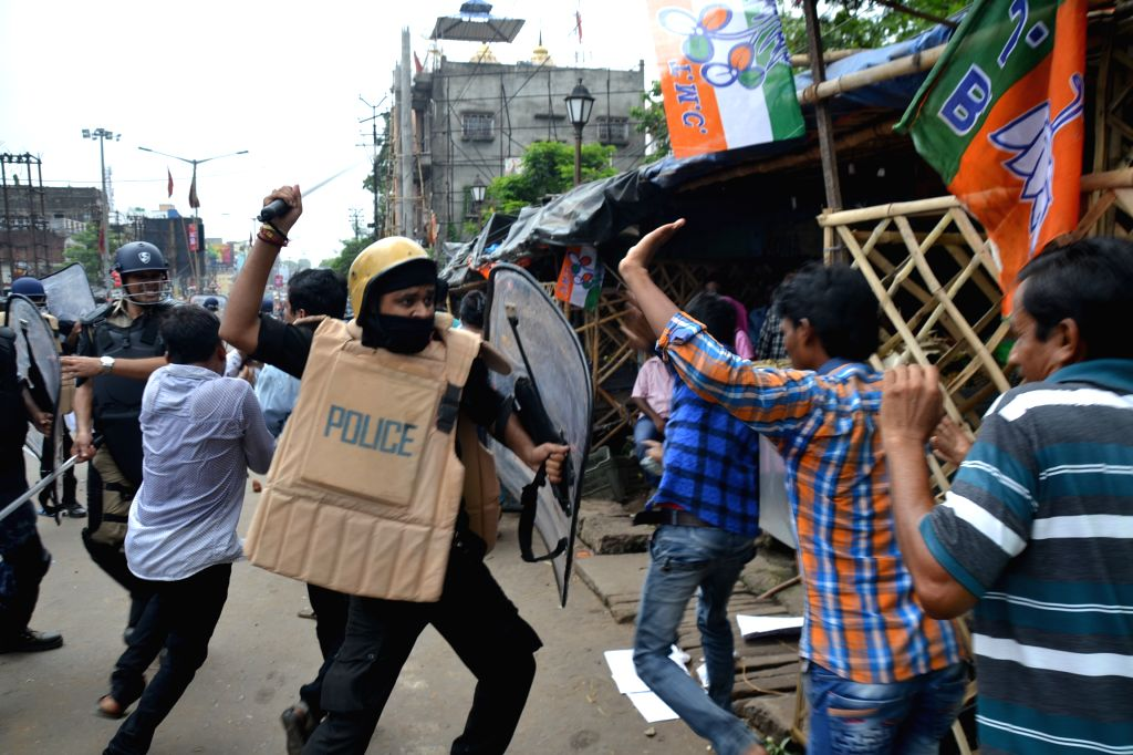 Asansol: Police resorted to lathi-charge to disperse an irate mob after a BJP-called a rally to submit deputation on the cut-money issue before the Asansol Municipal Corporation in West Bengal turned violent, in Asansol on July 5, 2019. (Photo: IANS)