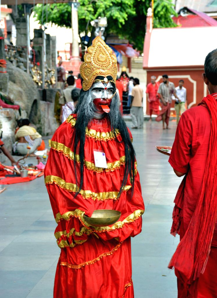 Ascetics arrive at the Kamakhya Temple ahead of Ambubachi Mela, also known as Ambubasi festival in Guwahati on June 19, 2014.