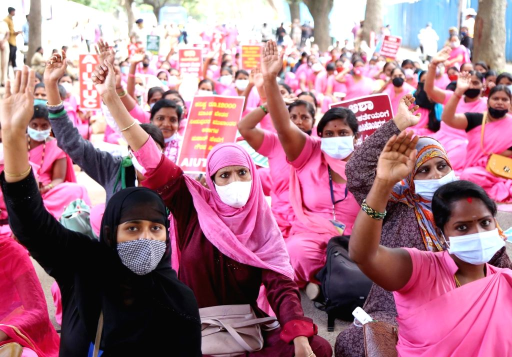 ASHA (Accredited Social Health Activist) workers stage a demonstration to press for a hike in their wages and provide safety kits in the wake of COVID-19 pandemic, in Bengaluru on Sep 23, ...