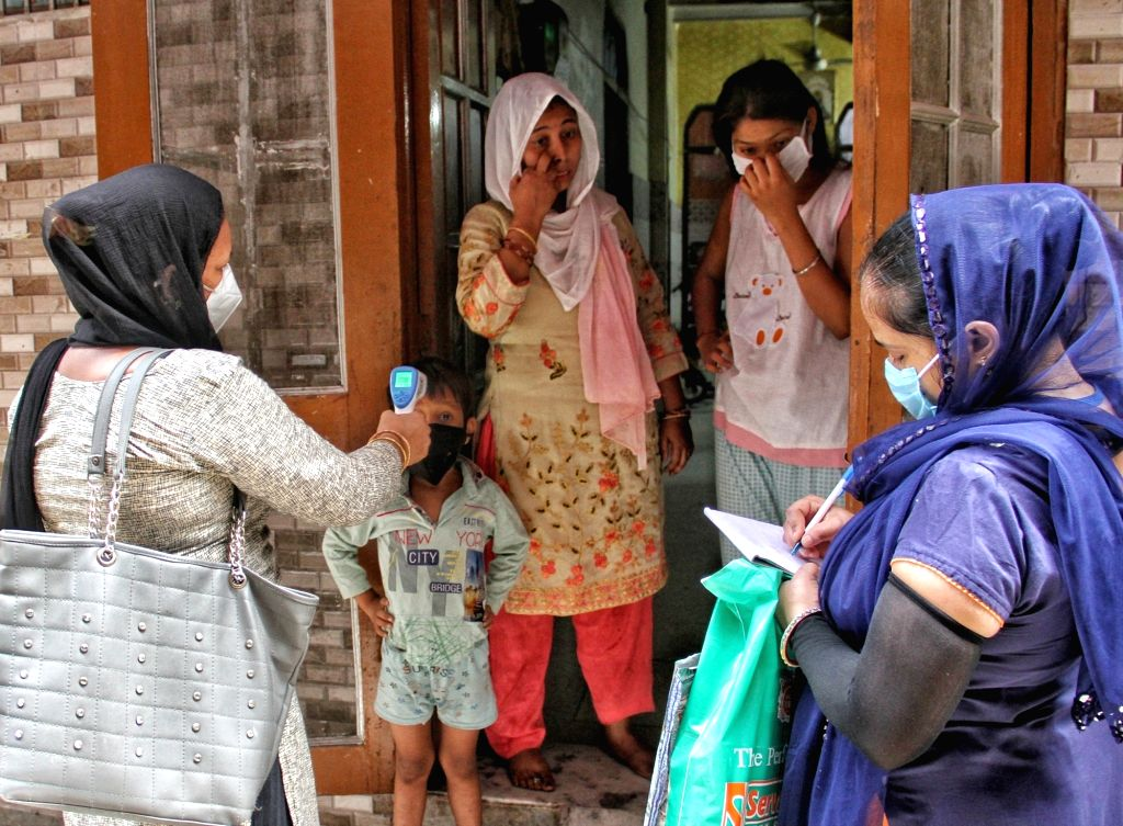 ASHA workers conduct door-to-door screening for COVID-19 in a Delhi locality amid coronavirus pandemic, on July 10, 2020.