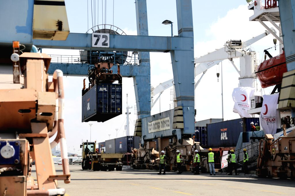 """ASHDOD, July 4, 2016 - People unload containers from """"Lady Leyla"""" at a port of Ashdod, Israel, on July 3, 2016. The Turkish ship with humanitarian aid to the besieged Gaza Strip docked on ..."""