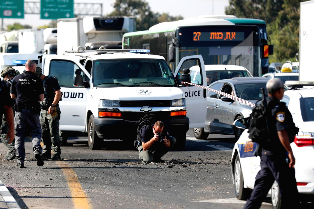 ASHDOD, Nov. 12, 2019 - Israeli policemen inspect a hole in the highway in the Israeli city of Ashdod, Nov. 12, 2019. Some 50 rockets were fired on Tuesday morning at central and southern Israel, ...