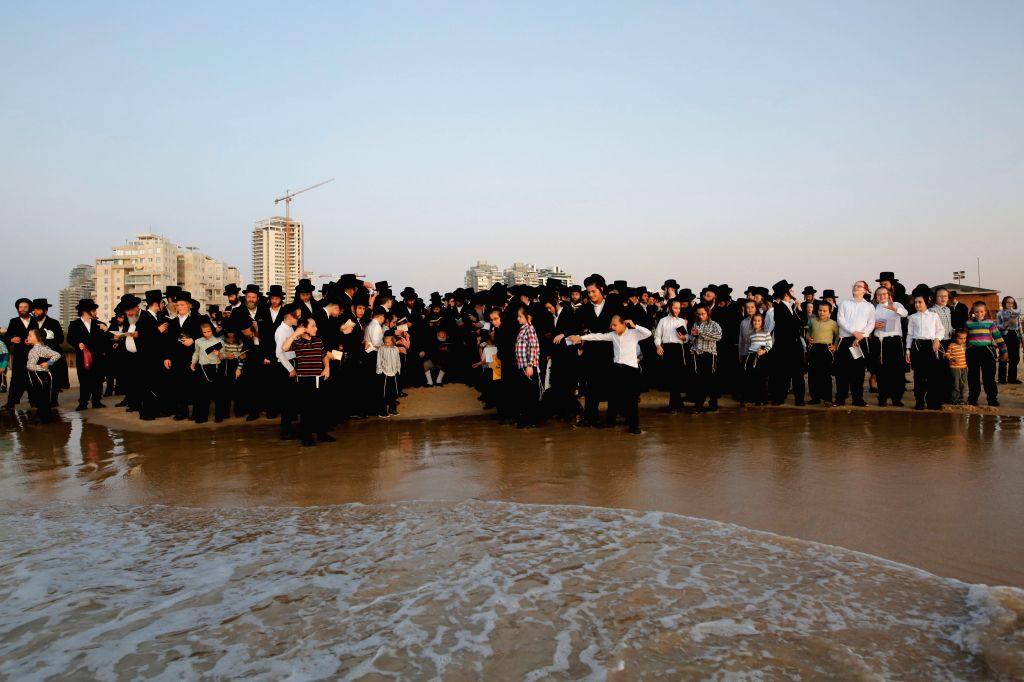 ASHDOD, Oct. 8, 2019 - Ultra-Orthodox Jews perform the Tashlich ritual on the shore of the Mediterranean Sea in Ashdod, Israel on Oct. 7, 2019, ahead of the Jewish holiday of Yom Kippur.
