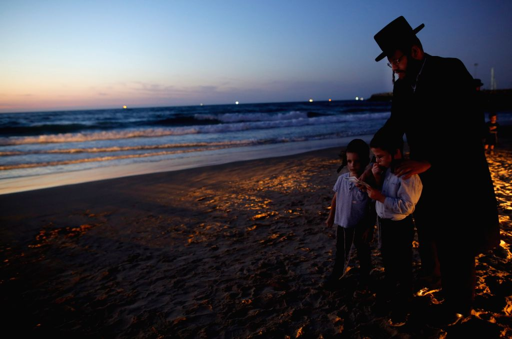ASHDOD, Oct. 8, 2019 - Ultra-Orthodox Jews perform the Tashlich ritual on the shore of the Mediterranean Sea in Ashdod, Israel on Oct. 7, 2019, ahead of the Jewish holiday of Yom Kippur.