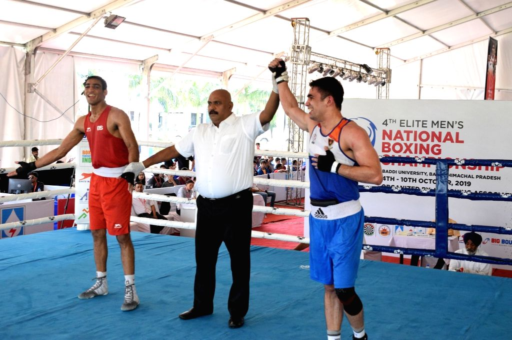 Ashish Chaudhary of Himachal Pradesh after defeating Rohit Tokas of Railways in a quarter-final match in the 75 kg category of the 4th Elite National Men's Boxing Championship at Baddi ... - Ashish Chaudhary
