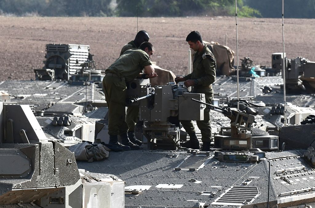 ASHKELON, Nov. 13, 2019 - Israeli soldiers stand on top of their Armored Personnel Carriers deployed at the Gaza border near the city of Ashkelon, south of Israel, on Nov. 13, 2019. Israel's army ...