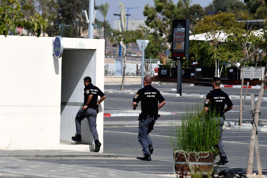ASHKELON, Nov. 13, 2019 - Israelis run toward a bomb shelter near the city of Ashkelon, south of Israel, on Nov. 13, 2019. Israel's army deployed artillery near the Gaza Strip border on Wednesday ...