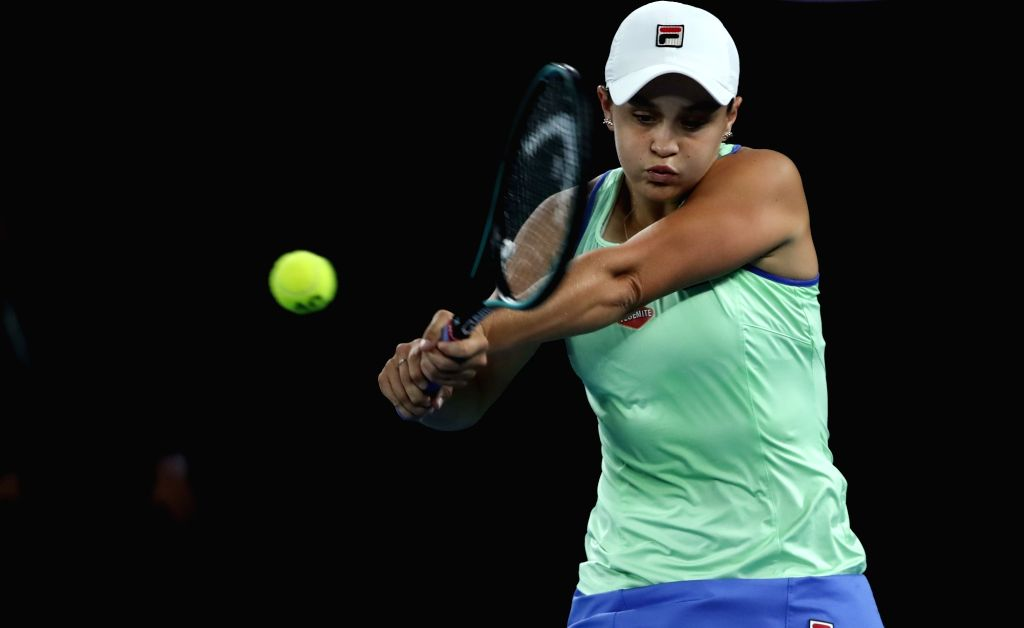 Ashleigh Barty of Australia hits a return during the women's singles fourth round match against Alison Riske of the United States at the Australian Open tennis ...