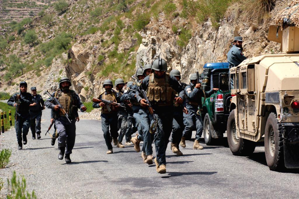 ASMAR, Aug. 10, 2017 - Afghan security force members take part in a military operation in Asmar district of Kunar province, eastern Afghanistan, on Aug. 10, 2017. (Xinhua/Emran waak)