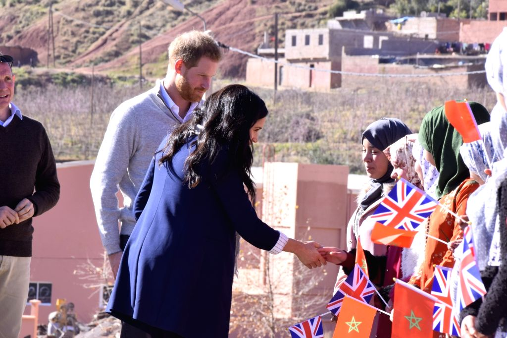 ASNI (MOROCCO), Feb. 24, 2019 The UK's Prince Harry (2nd L) and his wife Meghan (3rd L) visit a boarding house in Asni, Morocco, on Feb. 24, 2019. Prince Harry and his wife Meghan on ...