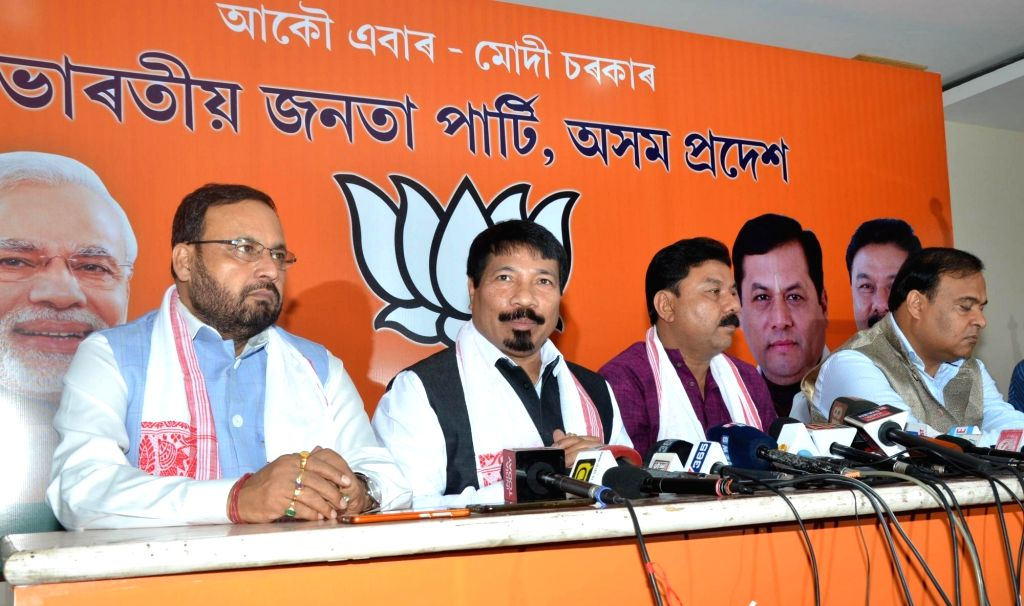 Asom Gana Parishad (AGP) President Atul Vora accompanied by party leader Prafulla Kumar Mahanta and BJP leader Himanta Biswa Sarma, addresses at AGP-BJP joint press conference in Guwahati, ... - Prafulla Kumar Mahanta