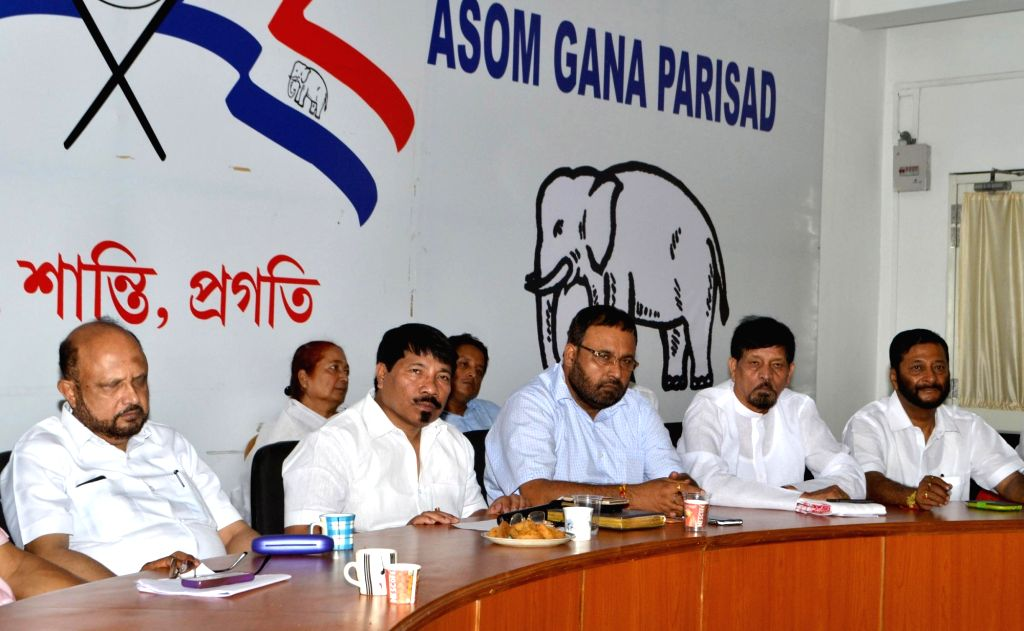 Asom Gana Parishad president Atul Bora, party leader Prafulla Kumar Mahanta and others during a party meeting in Guwahati on July 1, 2016. - Prafulla Kumar Mahanta