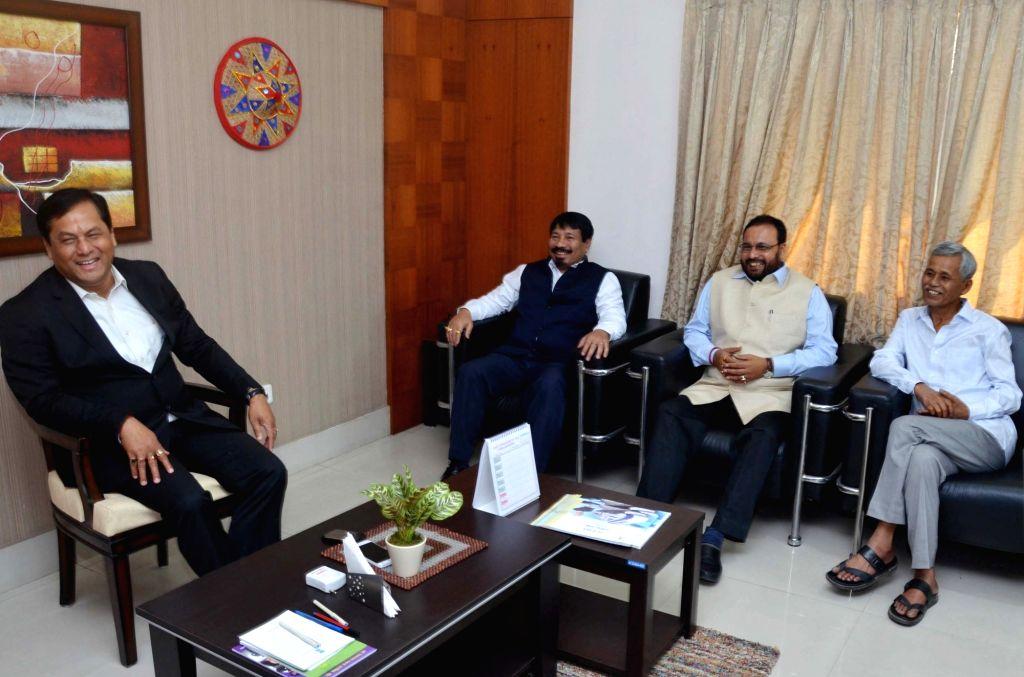 Assam Chief Minister and BJP leader Sarbananda Sonowal during a meeting with Asom Gana Parishad (AGP) President Atul Bora and party leaders Keshab Mahanta and Phanibhushan Choudhury in ... - Phanibhushan Choudhury