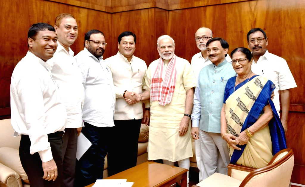 Assam Chief Minister Sarbananda Sonowal along with a delegation of MPs meets Prime Minister Narendra Modi at Parliament House in New Delhi on Aug 5, 2016. - Sarbananda Sonowal and Narendra Modi