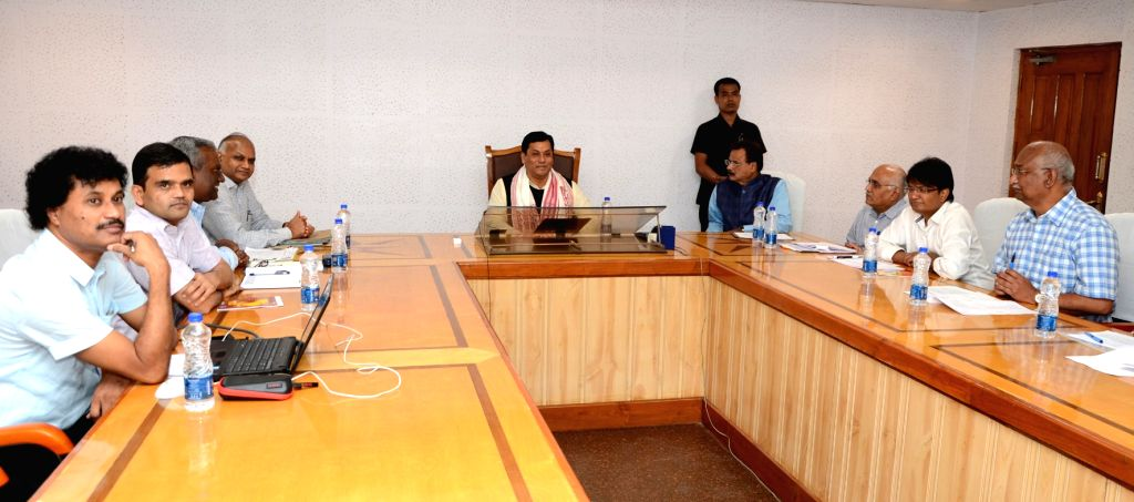 Assam Chief Minister Sarbananda Sonowal and Commerce and Industry Minister Chandra Mohan Patowari during a meeting to finalise 100 days programme of Industry Department in the conference ... - Sarbananda Sonowal