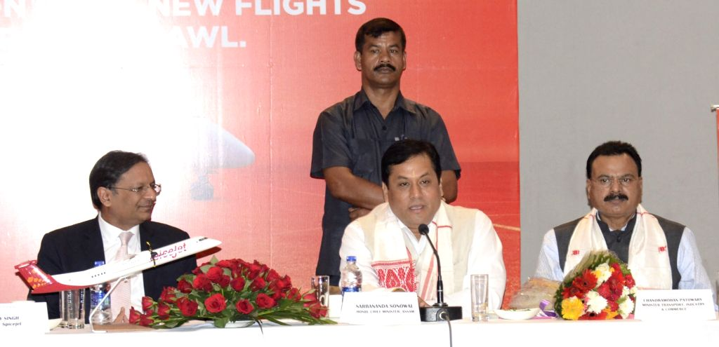 Assam Chief Minister Sarbananda Sonowal and Spicejet CMD Ajay Singh during a programme organised to announce new Spicejet flights from Guwahati; in Guwahati on Oct 3, 2016. - Sarbananda Sonowal and Ajay Singh