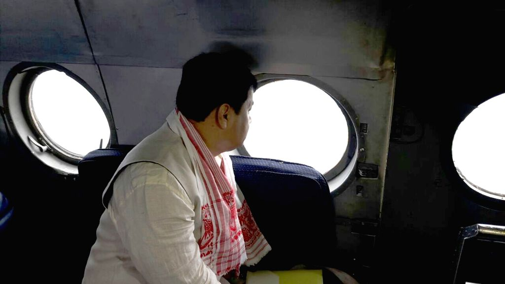 Assam Chief Minister Sarbananda Sonowal conducts aerial survey of flood affected areas of the state on July 28, 2016. - Sarbananda Sonowal