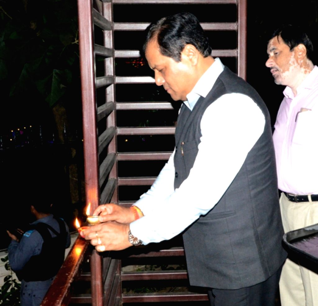 Assam Chief Minister Sarbananda Sonowal lights an earthen lamp at Brahmaputra State Guest House on Diwali in Guwahati on Oct 30, 2016. - Sarbananda Sonowal