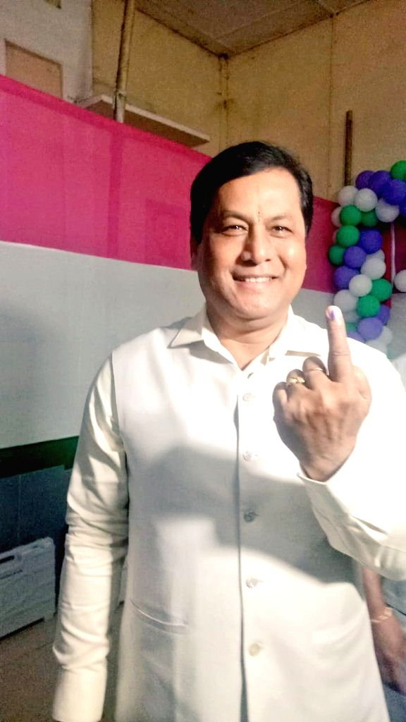 Assam Chief Minister Sarbananda Sonowal shows his inked finger after casting his vote for the 2019 Lok Sabha elections in Assam's Dibrugarh, on April 11, 2019. - Sarbananda Sonowal