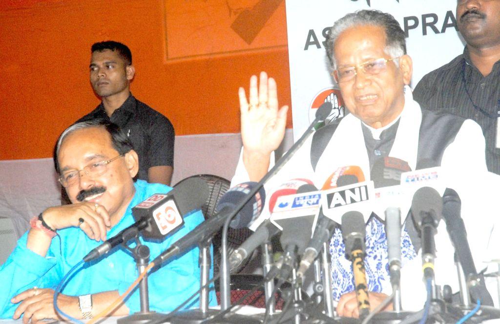 Assam Chief Minister Tarun Gogoi addresses a press conference in Guwahati on April 16, 2016. Also seen APCC president Anjan Dutta. - Tarun Gogoi