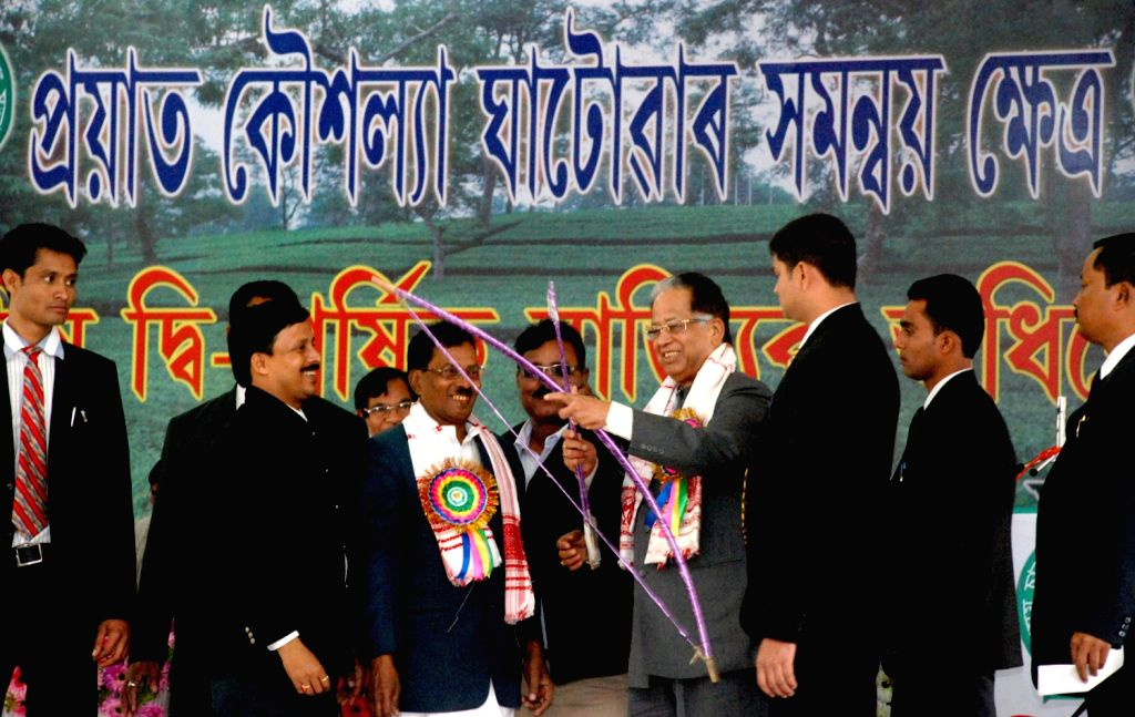 Assam Chief Minister Tarun Gogoi being felicitated with a traditional bow and arrow at Assam Cha Jonagosthi Sahitya Sabha Session held at Manav Kalyan Trust Pujabhawan in Tinsukia on Dec.22, 2013.