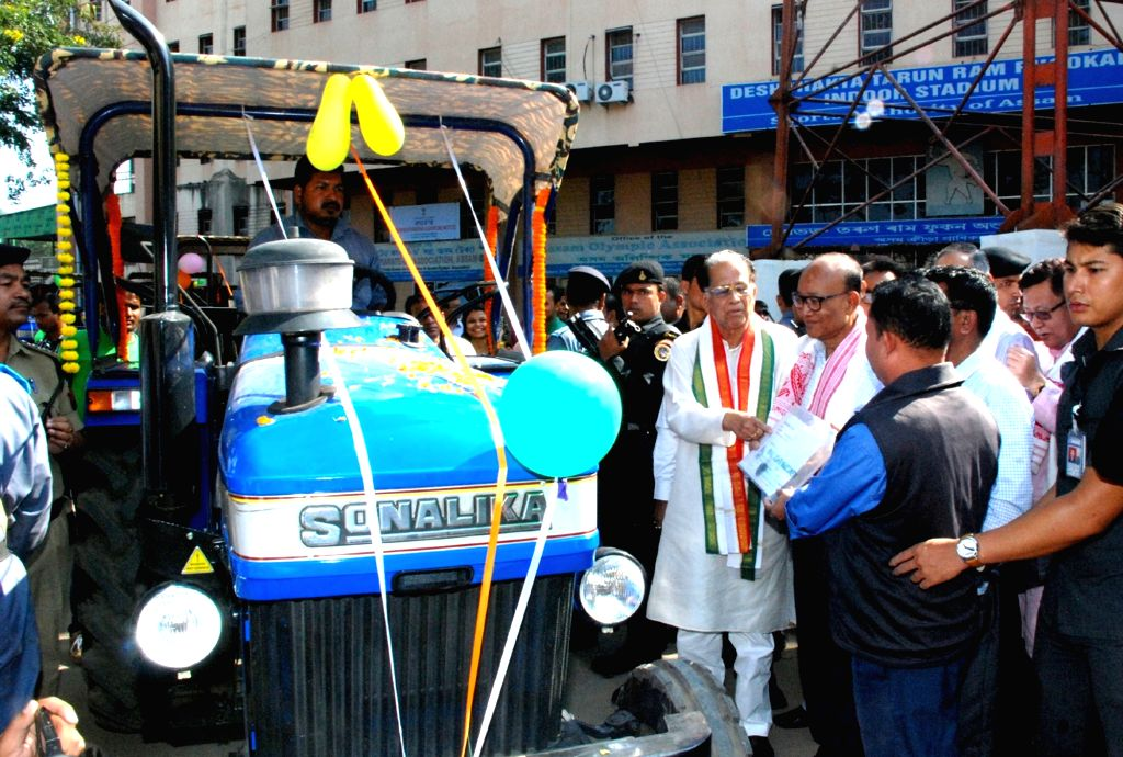 Assam Chief Minister Tarun Gogoi distributes tractors to SHGs during the foundation stone laying ceremony of Solapara Harijan Housing Colony at the premises of Nehru Stadium in Guwahati on ...