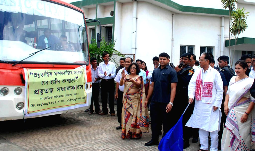 Assam Chief Minister Tarun Gogoi  flags-off a fleet of busses taking students on a tour of archaeological sites from Srimanta Sankaradeva Kalakshetra in Guwahati on Sept 8, 2014. - Tarun Gogoi