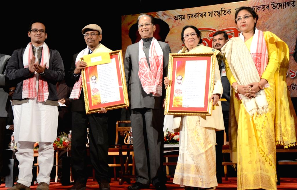 Assam Chief Minister Tarun Gogoi give away Silpi Award to Geeta Hatikakati and Anupam Choudhury on the occasion of Silpi Divas at Rabindra Bhawan in Guwahati, on Jan 18, 2016. - Anupam Choudhury