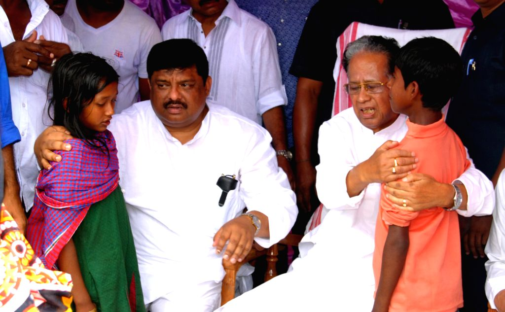 Assam Chief Minister Tarun Gogoi interacts with children during his visit to Narayanguri Relief Camp setup to provide shelter to those who fled their villages after recent violence in Bodoland ...