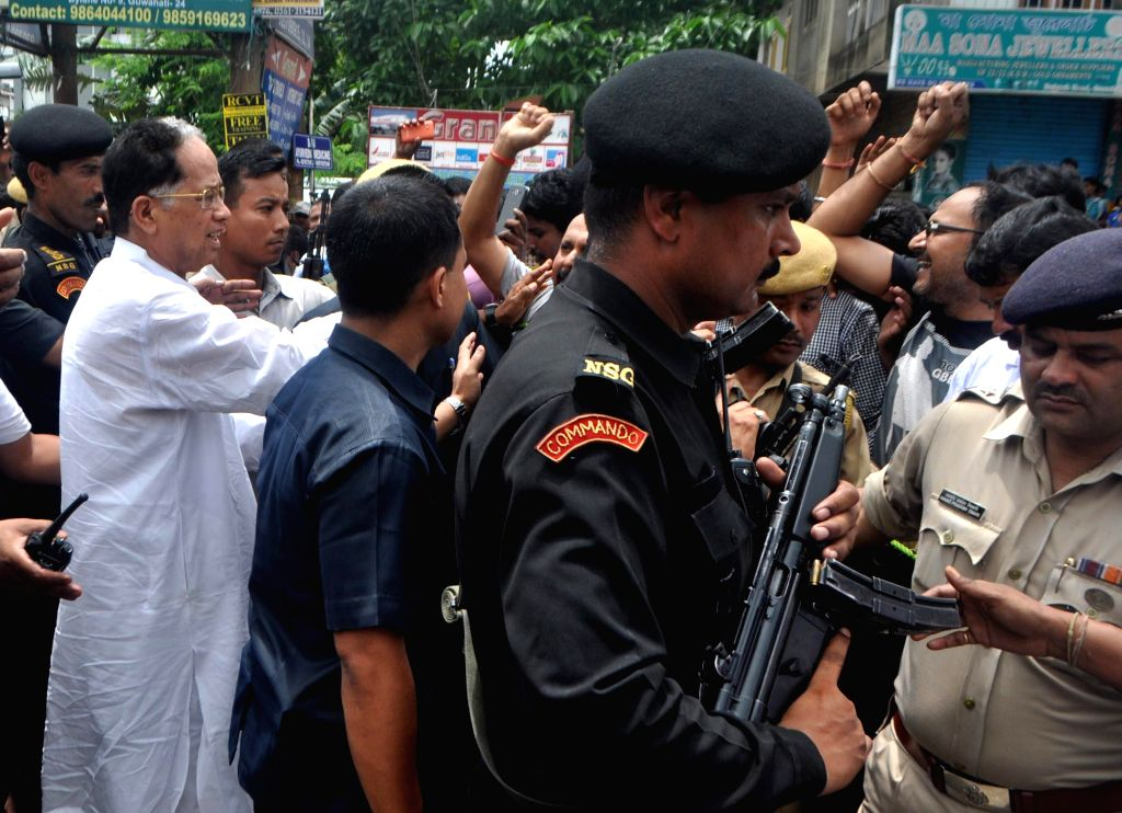 Assam Chief Minister Tarun Gogoi interacts with the residents of the flood hit Rajgarh area in Guwahati on June 27, 2014.