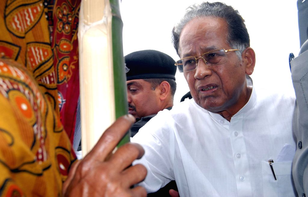 Assam Chief Minister Tarun Gogoi interacts with a lady during his visit to Narayanguri Relief Camp setup to provide shelter to those who fled their villages after recent violence in Bodoland ...