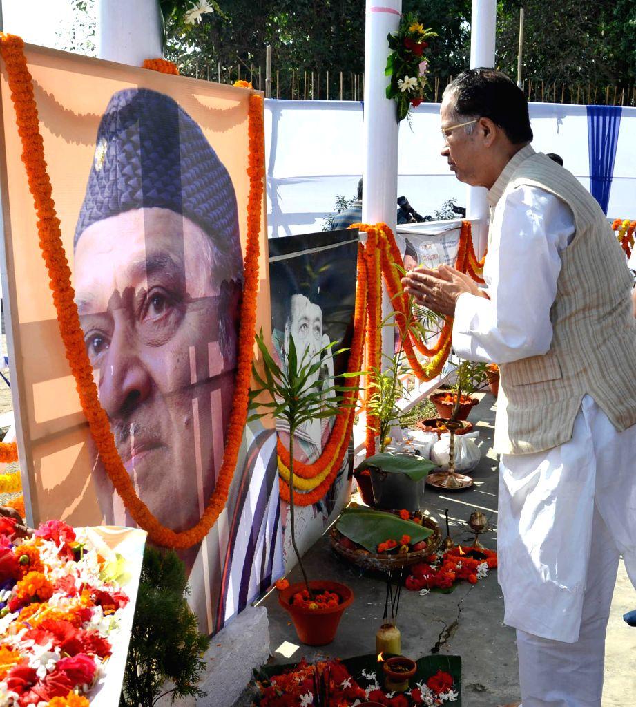 Assam Chief Minister Tarun Gogoi pays floral tribute to the legendary singer Bhupen Hazarika during a programme organised on Hazarika's 88th birth anniversary in Guwahati on Sept 8, 2014. - Tarun Gogoi