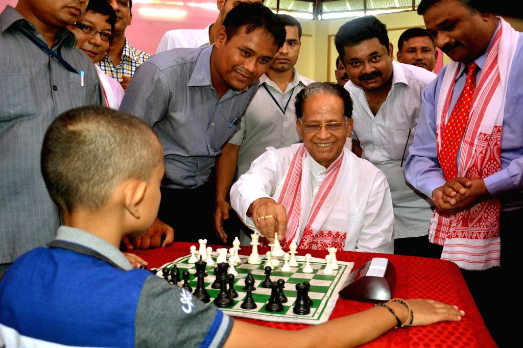 Assam Chief Minister Tarun Gogoi plays chess with a child during inauguration of `1st Asom International Open FIDE Chess Tournament -2014` in Guwahati on July 15, 2014. - Tarun Gogoi