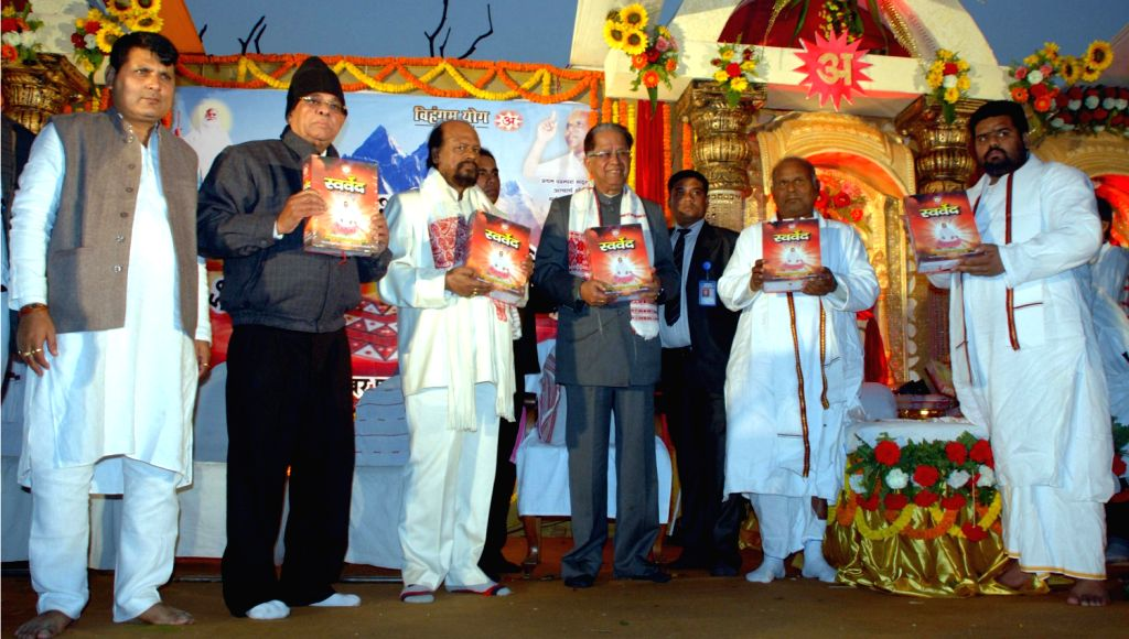 Assam Chief Minister Tarun Gogoi releases a religious book at the 501 Kundiya Vishwa Shanti Vedik Mahayagya organised by Purbachal Brahmavidya Vihangam Yoga Sangsthan at Sonaram High School field in .