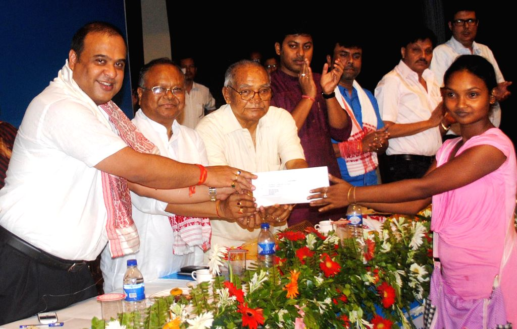 Assam Education and Health Minister Himanta Biswa Sarma distributes admission letters for GNM training course at Kalakshetra Auditorium in Guwahati on July 3, 2014.